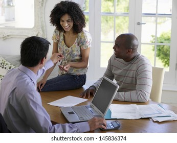 African American couple sitting at table with financial advisor