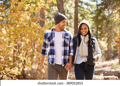 African American Couple Walking Through Fall Woodland