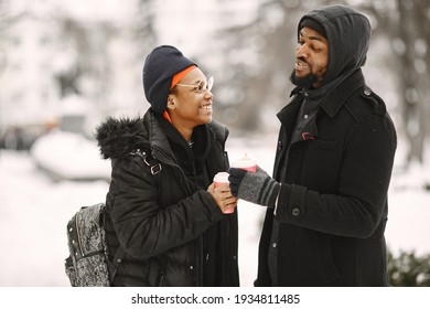 African american couple in a winter city