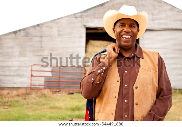 African American cowboy with an American flag.