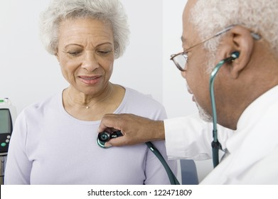 African American doctor checking patient using stethoscope