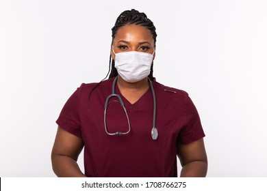 African american doctor in a medical mask over white background. Medicine, healthcare and people concept.