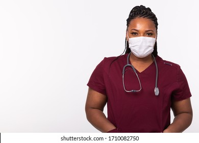 African american doctor in a medical mask over white background with copy space. Medicine, healthcare and people concept.