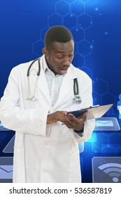 African American doctor shocked and scared by information on a clipboard.