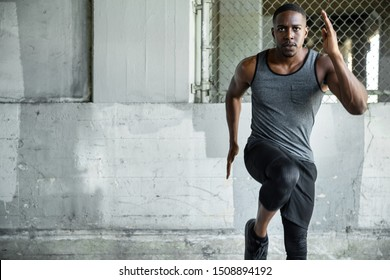 African american exercising in urban area on concrete surface, cardio, high endurance fit training, copy space