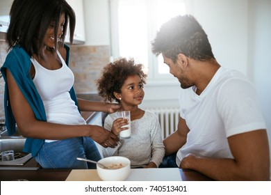 African american family bonding at breakfast at home.