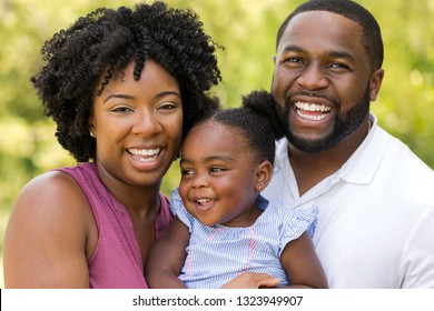 African American family laughing and smiling.