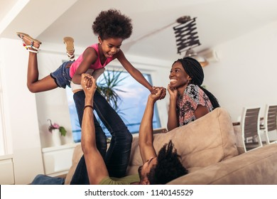 African american family spending time together at home. They are having fun