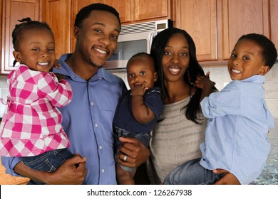 African American family together inside their home