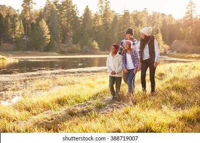 African American Family Walking By Lake