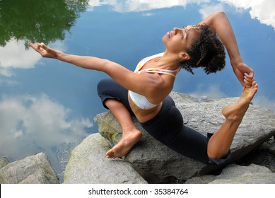african american female in king pigeon yoga pose
