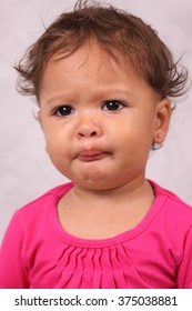 African American female toddler who is unhappy