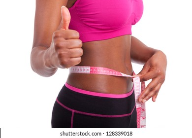 African American Fitness woman making thumbs up, isolated on white background