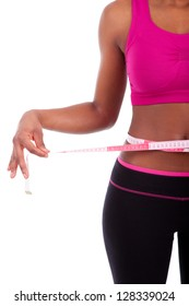 African American Fitness woman measuring her belly, isolated on white background