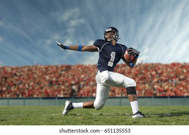 African American football player poised on field