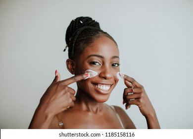 African American girl applying facial skincare product. Sexy woman face. Brutal sexy face girl. Hot babe. Erotic concept. Erotica. Passionate concept. Passion. Adult . Sensual. Sensuality