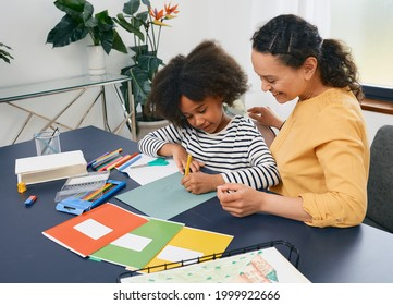 African American girl with autistic disorder with child's psychologist while psychological treatments for kid - Shutterstock ID 1999922666