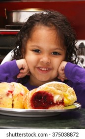 African American girl excitedly waiting to eat her Paczki on Fat Tuesday