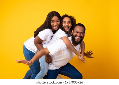 African American girl laughing with her mom and dad