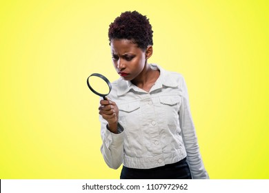 African American girl with magnifying glass