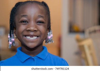 African American girl missing her front teeth