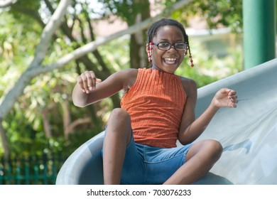 African American girl on a slide at a playground