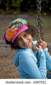 African American girl on the swing