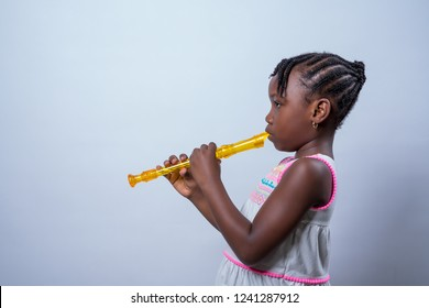 African American girl with recorder