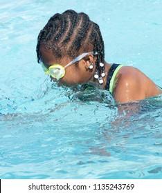African American girl swimming in a pool