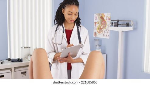 African American gynecologist examining patient