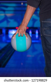 African American hand holding a bowling ball