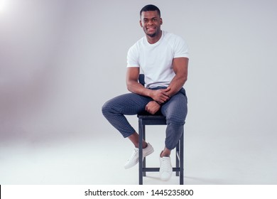 African American healthy male model in a cotton white t-shirt in studio