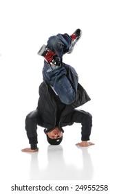African American hip hop dancer performing headstand