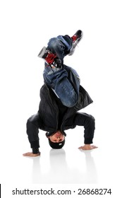 African American hip hop dancer performing a head stand