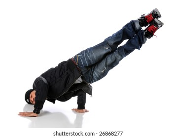 African American hip hop dancer performing a side hand and head stand