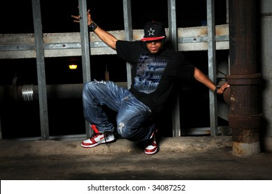 African American hip hop dancer performing in old building