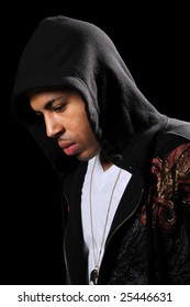 African American hip hop man wearing hood isolated over black