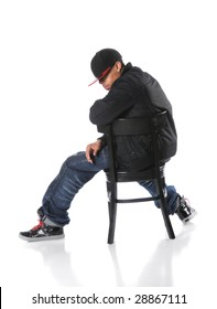 African American hip hop man sitting on chair over a white background
