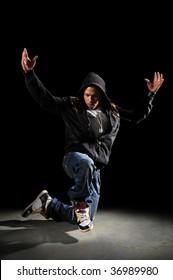 African American hip hop man dancing over dark background