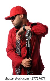 African American hip hop musician posing with vintage microphone