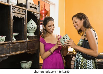 African American and Indian women shopping together for home decor.