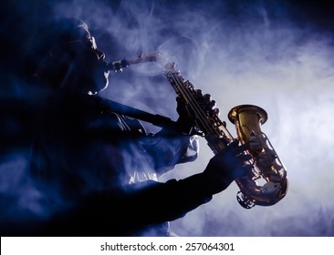Photo of African American jazz musician playing the saxophone