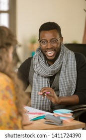 African American laughing man in an office with client or coleague