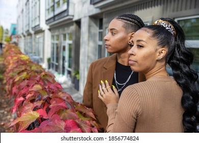 African American lesbian couple together outside with Fall leave