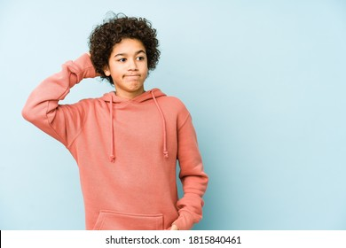 African american little boy isolated touching back of head, thinking and making a choice.