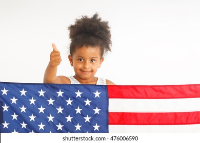 African American little girl showing thumb up. American flag on the front