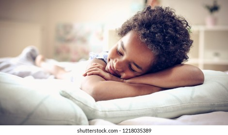 African American little girl sleeping in bed. Space for copy. Close up.