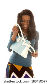 an African American looking in to the bag with a smile on her face.