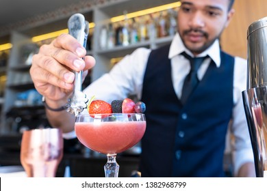 African American Making Barman Making a Cocktail