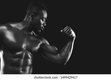 African american male fitness model demonstrating his strong arm, free space, black and white photo